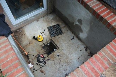 flooding window wells is to install a sump pump into the window well