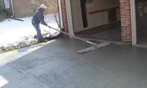 Bull floating and finishing concrete driveway Centerville Virginia