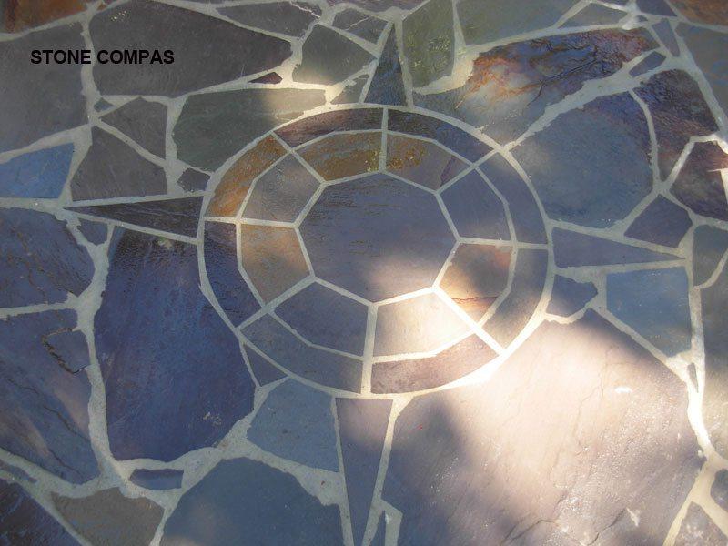 Custom flagstone compass, shot true north, and then cut into a irregular flagstone patio in great falls Virginia