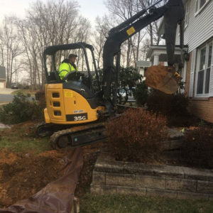digging out a basement with an excavator for waterproofing in northern Virginia