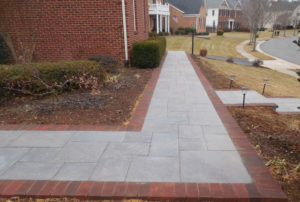 Clay brick lined paver walkway